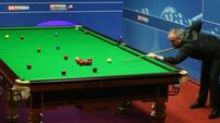 Mark Selby and John Higgins progress at the Crucible