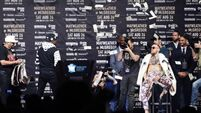 Floyd Mayweather throws dollar bills at Conor McGregor as press tour continues