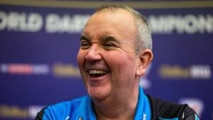 Phil Taylor eases into second round of PDC World Darts Championship
