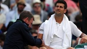 Roger Federer progresses but injury forces Novak Djokovic out of Wimbledon
