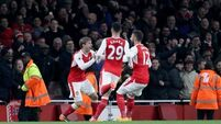 Late own goal keeps Gunners hopes of top four alive