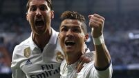 Ronaldo hat-trick all but knocks Atletico out