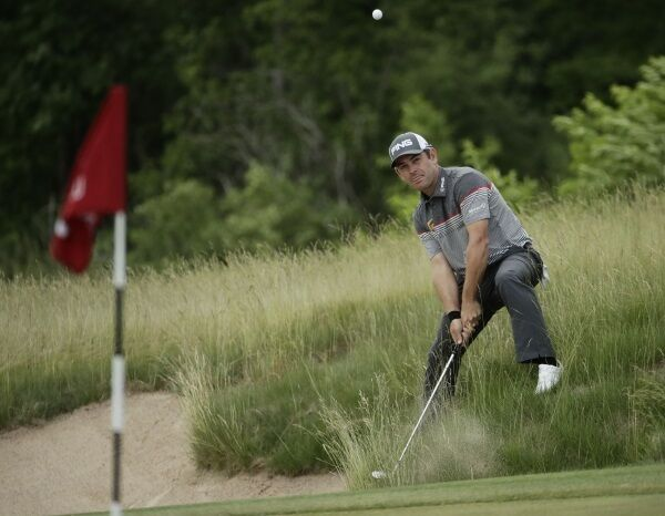 Louis Oosthuizen hits from a bunker on the third hole during the fourth round.