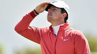 Rory McIlroy keeps an eye on the sky at the open championship