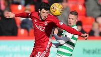 Leaders Celtic show title credentials with late win at Aberdeen