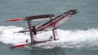 Watch Team New Zealand's catamaran capsize spectacularly in the America's Cup