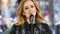 Adele supports grieving fans at Grenfell Tower in London