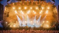 Hozier surprises fans by joining Mumford and Sons on stage at Longitude