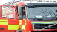 One taken to hospital after house fire in Dublin