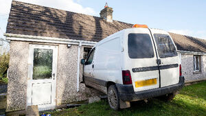 PHOTOS: Pensioner escapes with cuts and bruises after van crashes through her kitchen window