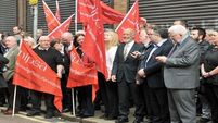 Hundreds 'stand strong' alongside threatened probation officers in Belfast