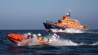 RNLI rescue two sailors from capsized dinghy in Dublin Bay