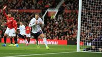 Lallana's late equaliser salvages point for leaders Liverpool against Man United