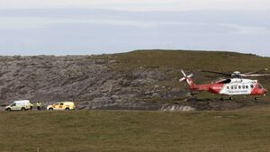 Emergency services launch land, air and sea search after fisherman swept away