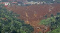 More than 300 dead, 600 missing, after mudslide engulfs people in Sierra Leone as they sleep