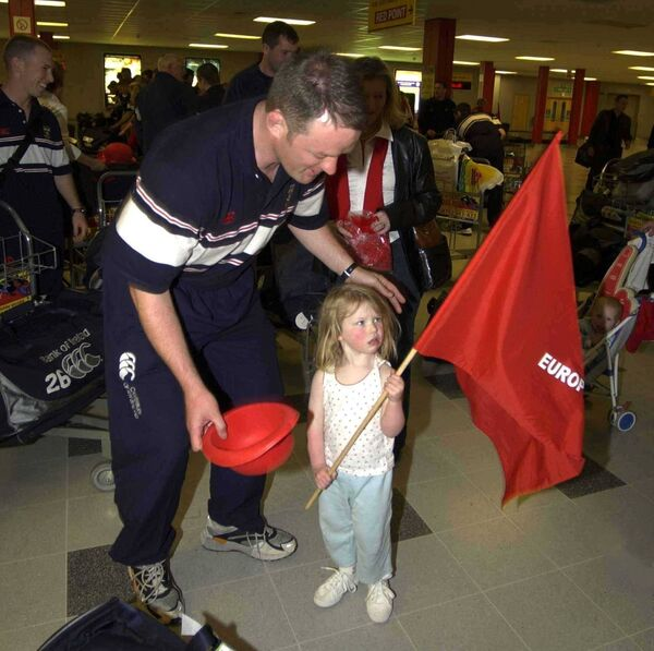 Munster captain Mick Galwey with his daughter Neasa on arrival in Cardiff Airport, prior to the Heineken European Cup Final against Leicester. Picture: Brendan Moran