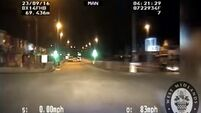 Footage shows banned driver trying to avoid police by going 115mph in 30mph zones