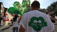 Notting Hill Carnival revellers hold minute's silence for Grenfell Tower victims