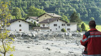 Eight missing after massive mudslide sweeps through Swiss village