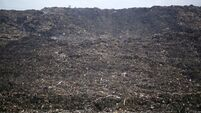 Two die after mountain of rubbish collapses in India
