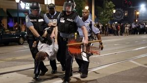 Police make nine arrests after peaceful St Louis protest turns violent