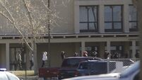 Students hid in classrooms as gunman killed three at US high school