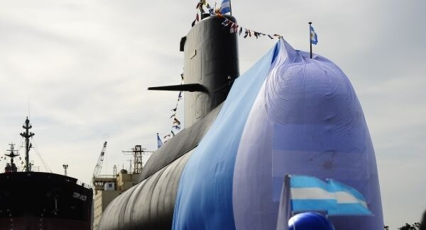 Workers stand around the ARA San Juan submarine during a ceremony in 2011.