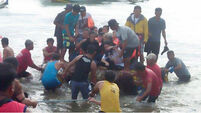 Philippines ferry capsizes in stormy seas