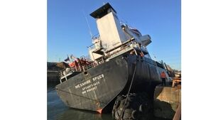 Listing cargo ship towed to safety in Southampton