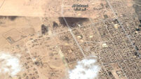 Air strike on IS-held Syrian village kills dozens