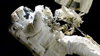 Astronaut repairs camera on spacewalk despite tether and jetpack problems