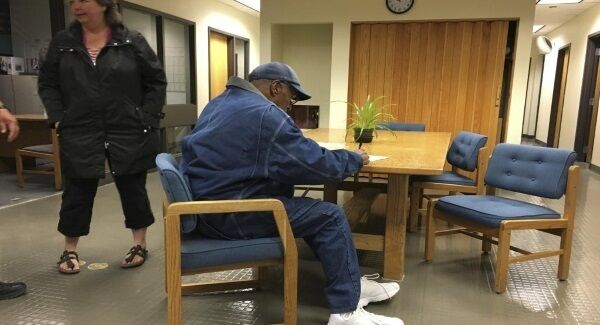 O.J. Simpson signs documents at the Lovelock Correctional Center, Saturday, September 30.
