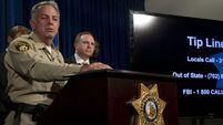 Latest: Las Vegas gunman stockpiled weapons and ammunition over decades