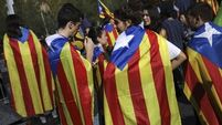 Latest: Confusion as Catalan leader cancels televised address