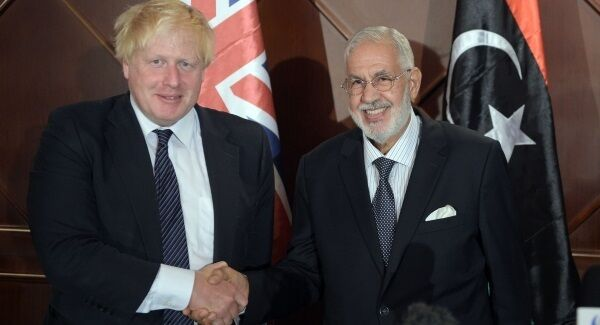File photo from August of Boris Johnson shaking hands with Libyan Foreign Minister Mohamed Taha Siala.