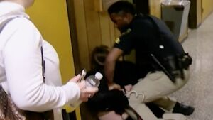 Watch teacher being handcuffed and arrested after she questions superintendent's pay rise