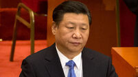 Chinese president urges strong stand against 'grim' challenges
