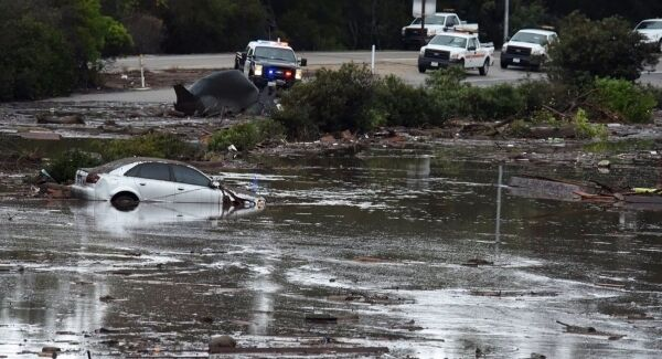 The US Highway 101 at the Olive Mill Road overpass flooded with runoff water from Montecito Creek in Montecito, California.