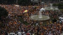 Thousands turn out in Madrid and Barcelona shouting 'I am Spanish' to celebrate Spain's national day