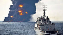 Oil slick from sunken tanker in East China Sea burns out