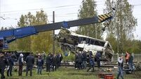 Train hits bus in Russia killing at least 19