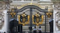 Woman who tried to climb Buckingham Palace gates charged with being drunk and disorderly