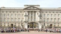 Woman arrested after attempting to scale Buckingham Palace front gates