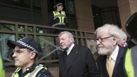 Protestors yell at Cardinal Pell outside sexual assault trial