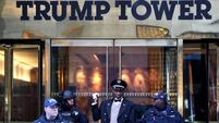 Latest: Three hurt as fire at Trump Tower brought under control