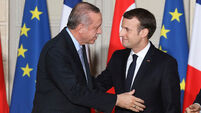 Human rights protesters greet Turkish president on visit to France