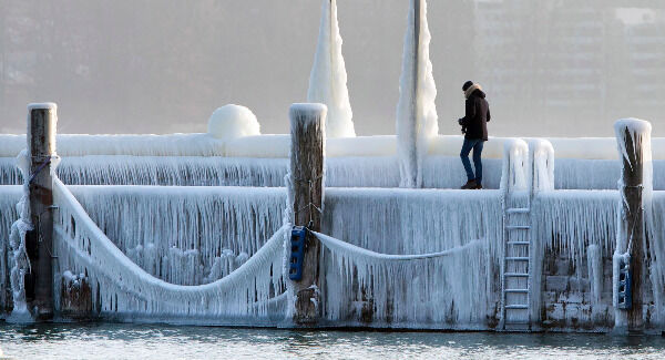 Ice covers the pier at the harbor of Constance at lake Constance, Germany. Pic: Steffen Schmidt/dpa via AP