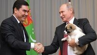 Watch Vladimir Putin's reaction when he gets a puppy for his birthday