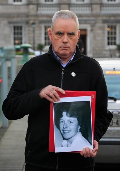 Maurice Frazer, holding a photograph of his sister, Thelma, at Leinster House, Dublin. Picture: Gareth Chaney Collins