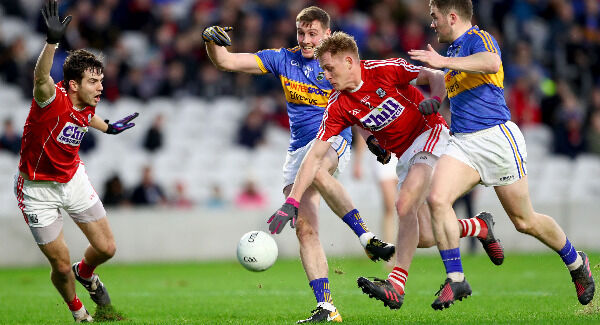 Cork's Jamie O'Sullivan and Sam Ryan tackles Conor Sweeney of Tipperary. Pic: ©INPHO/James Crombie